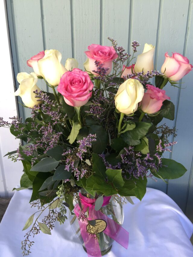 Pink and white roses mixture in vase