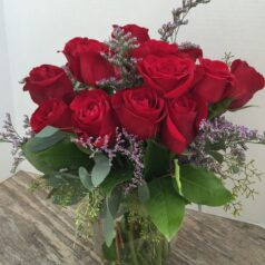Red roses in short vase