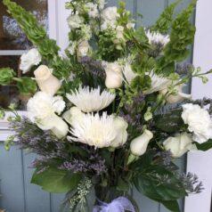 Tall white sympathy vase