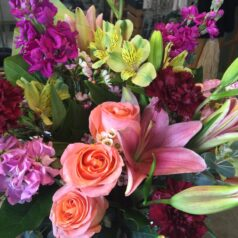 beautiful mixture with salmon roses pink lilies yellow alstro purple stock