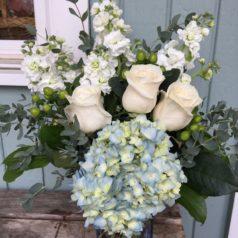 blue hydrangea white roses white stock