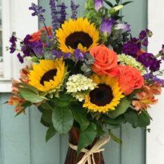 Sunflowers and orange roses